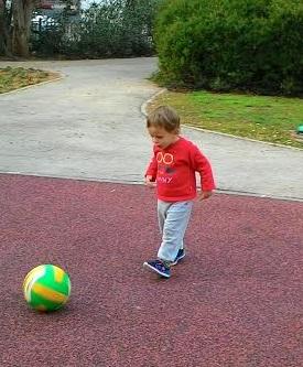 נכד בועט בכדור A grandson kicking a ball
