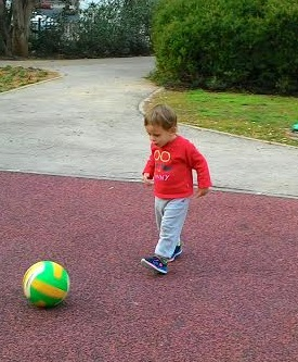 נכד בועט בכדור A grandson kicking a ball